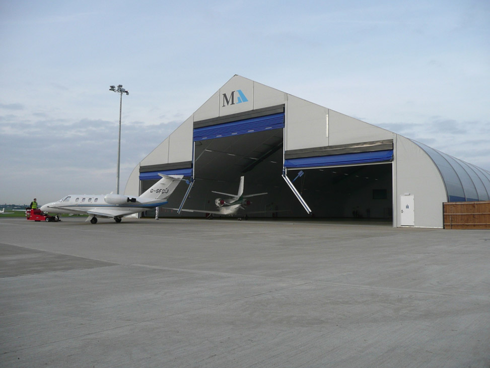 Multi-leaf bi-parting door system is available in both manual and power driven. & Aircraft Hangar Doors - Sprung Structures » Sprung Structures