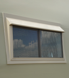 Sprung window with slider