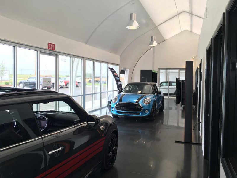 Temporary automotive dealership with internal offices and a space to display cars.