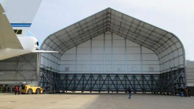 Sprung Tail Cover for Aircrafts portable structure for temporary building aircraft hangar expansion