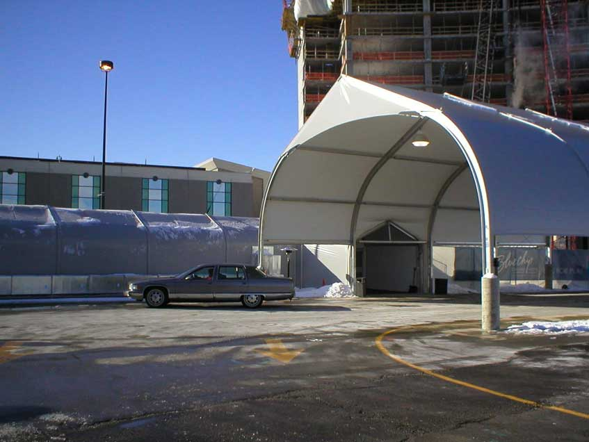 Sprung temporary structures connecting corridors for construction sites.