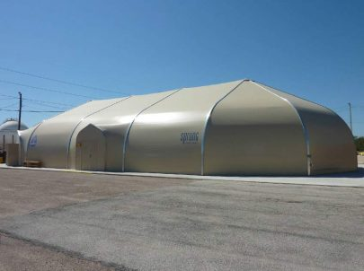 A safe, secure, weatherproof alternative to tent technology • Sprung structures are engineered for extreme wind and designed to shed snow • Can be constructed at a rate of up to 2000 sq ft per day • Highly tensioned exterior membrane provides quiet comfortable interior • Limited foundation requirements saves time and money • Daylight panels in peak allow natural daylight • Exterior all weather door hoods for added safety in high precipitation environments • Relocatable design adds flexibility for multi use applications • Cost effective leasing program with option to purchase